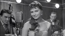 Poznáte slavnou hlasatelku, která si ve filmu Jiřího Krejčíka zahrála zpěvačku?