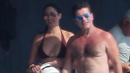 Simon Cowell s Lauren Silverman s jejich synem odjel na dovolenou.