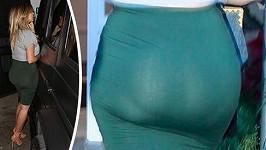 Kim Kardashian a její proslulé pozadí.