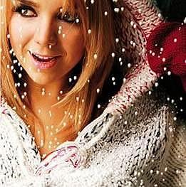 Lucie na přebalu svého loňského vánočního alba Dárek, které se stále skvěle prodává.