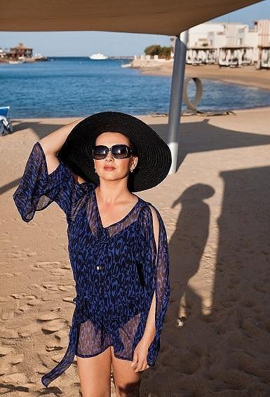 Dana na hotelové pláži.