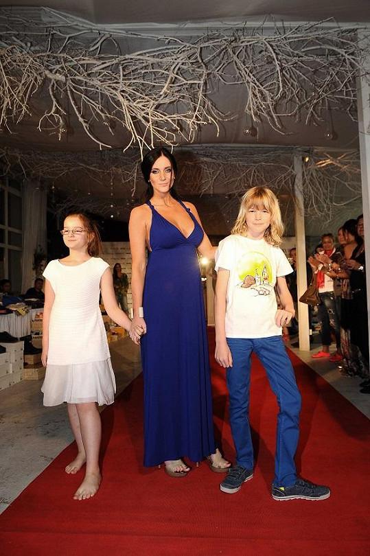 Jako těhulka si Andrea poprvé vyzkoušela roli modelky.