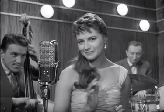 Ve filmu Jiřího Krejčíka Probuzení si Milena Vostřáková zahrála zpěvačku. Bylo jí 25 let.