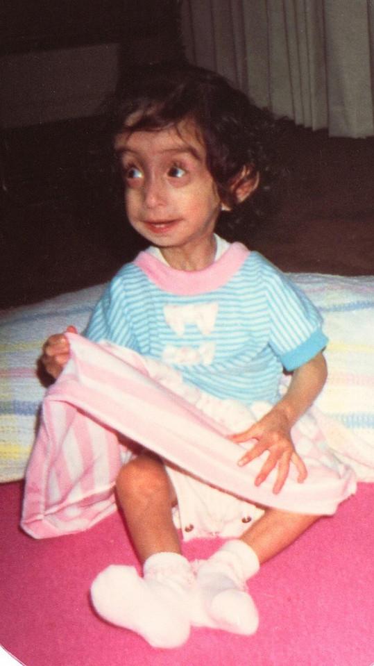 Lizzie na fotce z dětství