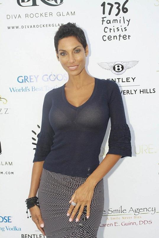 Hercova bývalá manželka Nicole Mitchell.