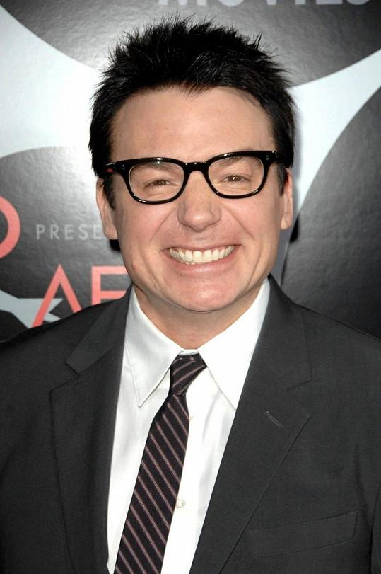 Šťastný otec Mike Myers.