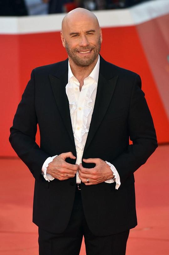 """John Travolta pitolování označil za """"druhou kariéru""""."""