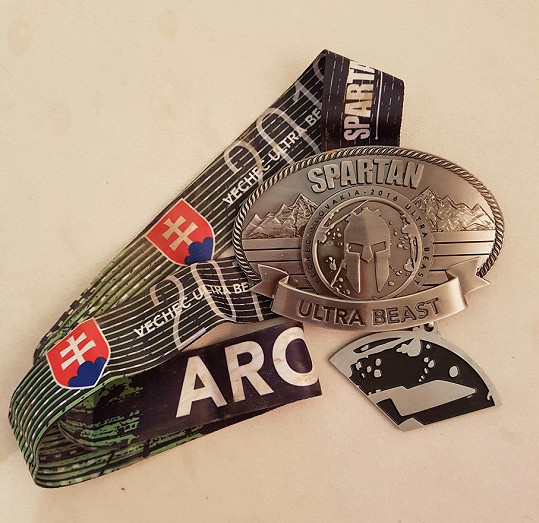 Medaile je doma.