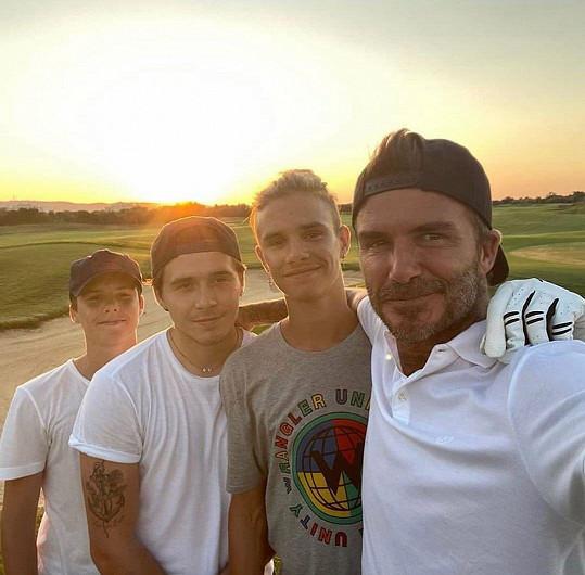 David se svými třemi syny.