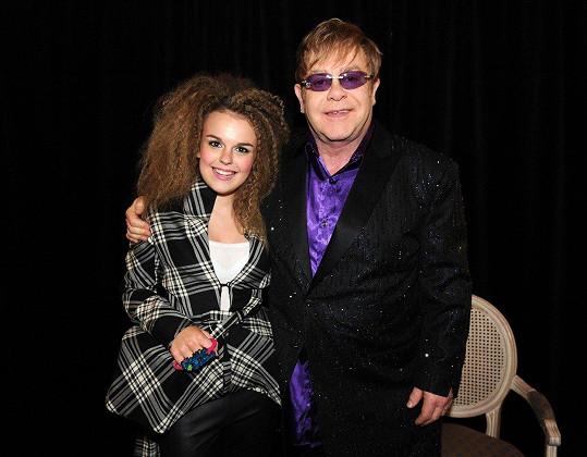 Tallia společně s Eltonem Johnem před jejich společným vystoupením v létě 2012