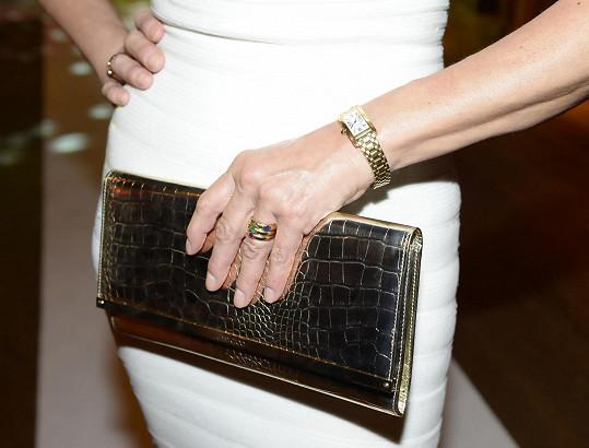 Stejné značky bylo i luxusní psaníčko, hodinky od Cartiera.