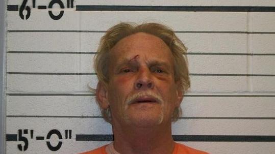 Bývalý soudce Donald D. Thompson na policejní fotografii.